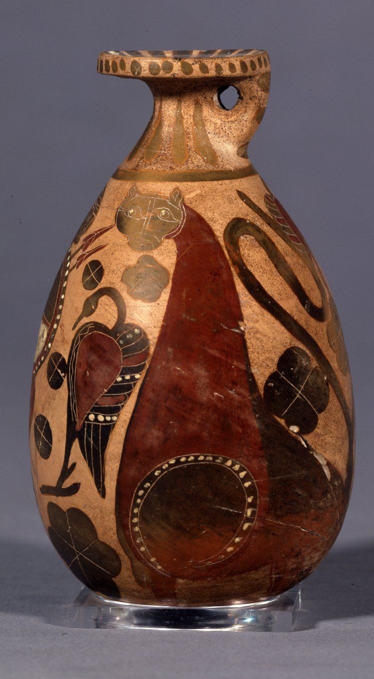 Pottery alabastron decorated with a warrior, panther, birds and plants.