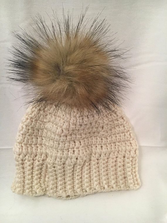 97f7b8941 A lovely cream hat made with alpaca wool, topped with a faux fur pom ...