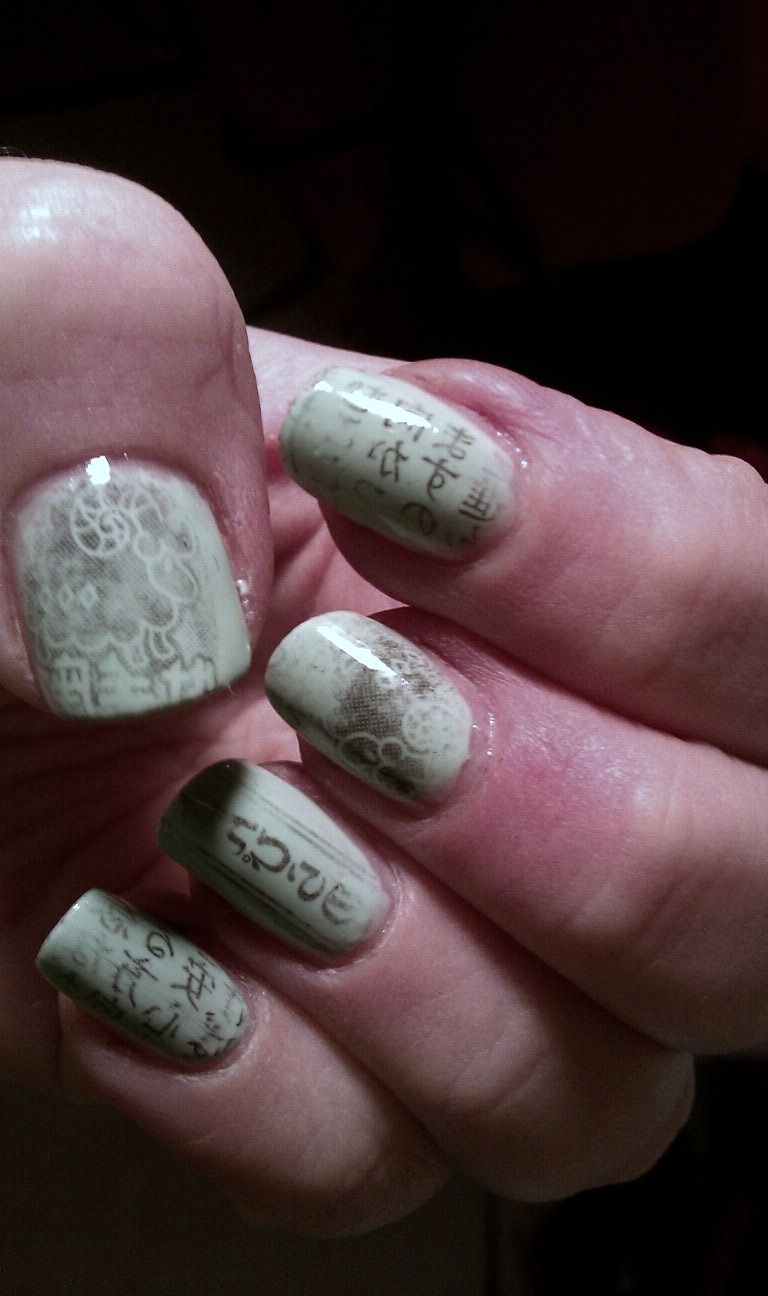 My take on newsprint nails. I used the horoscope section of the paper i got at the local Japanese market.