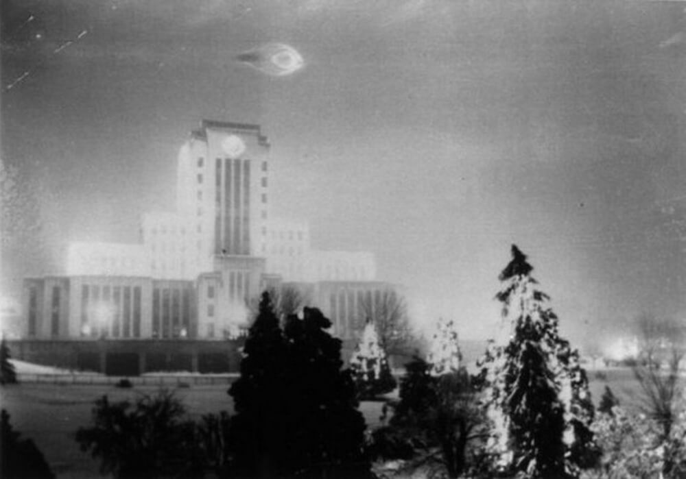 Almost 100 years ago, two bothers immortalized the moment when a 'flying disk' descended over their city to admire the vivid Christmas lights. Their image remains one of the first photographic evidence of a UFO