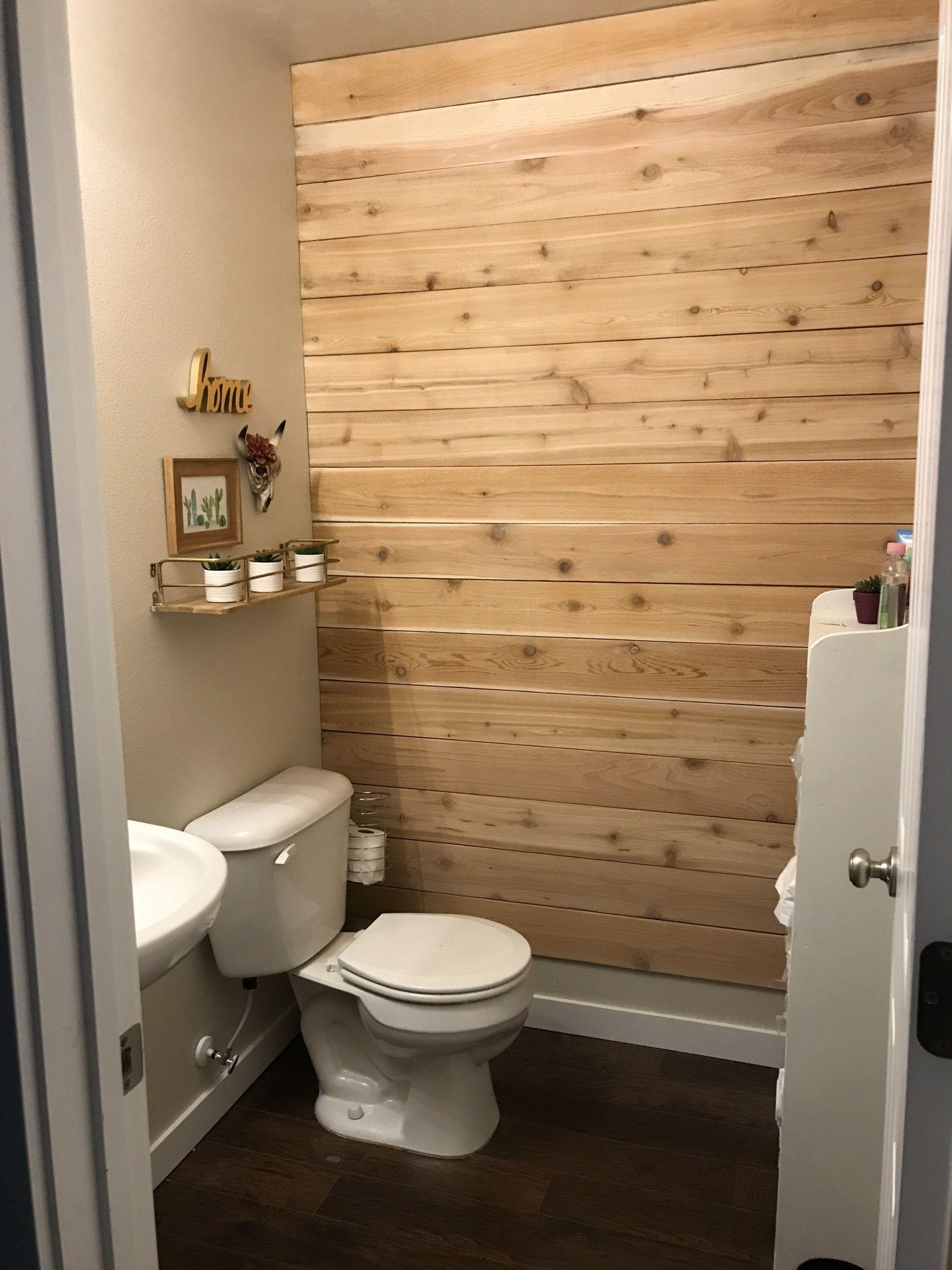 Diy Wood Plank Wall On A Budget Three Clementines Wood Plank Walls Plank Walls Pallet Wall Bathroom