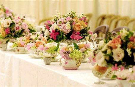 Cake stands and teacups filled with flowers