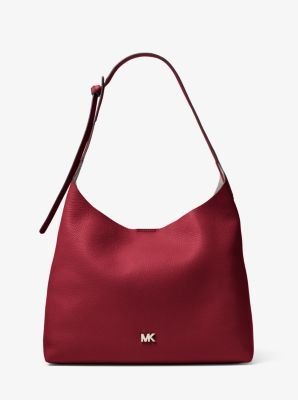 30520d58db2b Michael Kors · Our Junie shoulder bag is designed with understated hardware  for a minimalist take on the timeless