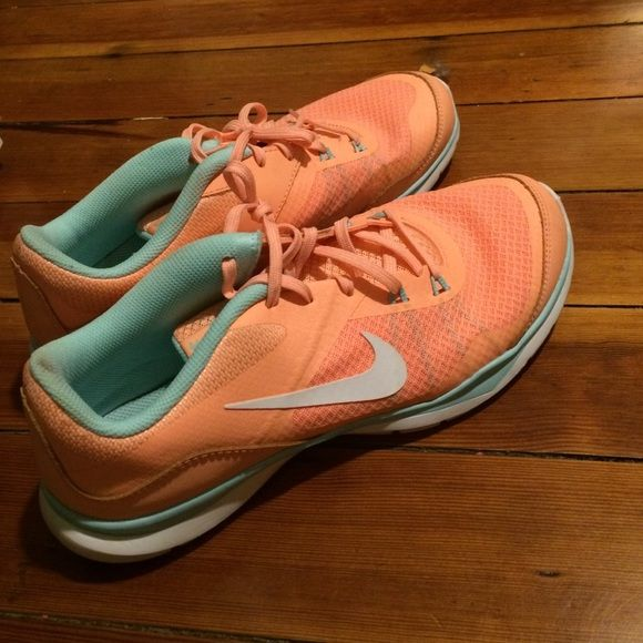 Nike Flex Tr 5 Shoes Only worn once or twice twice and are in great condition. Pretty peach color with some light blue Nike Shoes Athletic Shoes