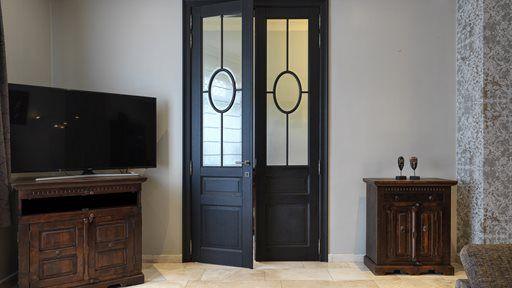 High double wooden door dark colored