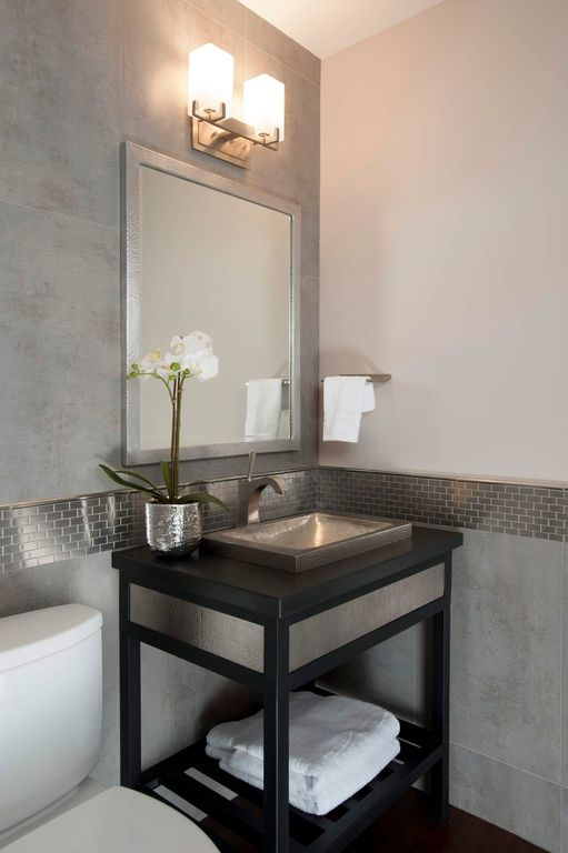 Modern powder room with hardwood floors powder room - Powder room tile ideas ...