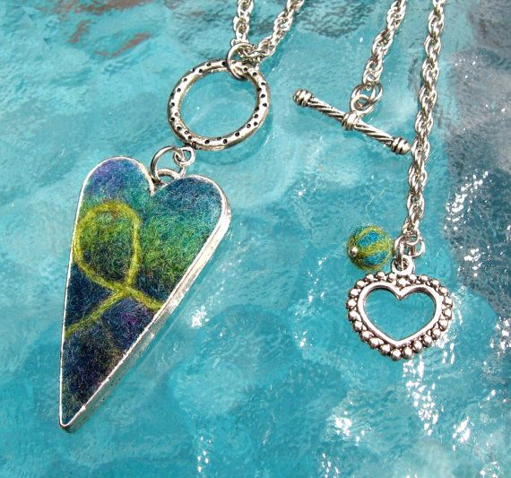 Heart-shaped pendant made felted merino wool hand and set into a silver bezel.  You can purchase only the pendant or the necklace with pendant. ***