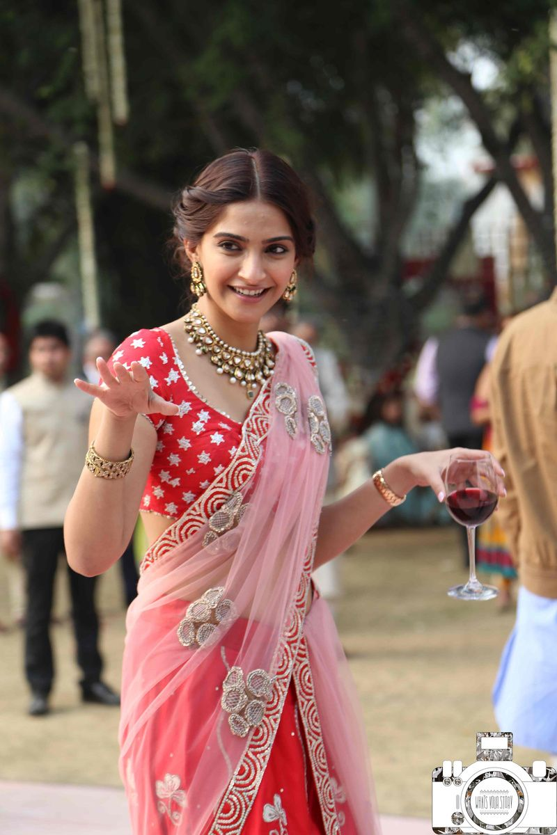 Sonam kapoor at wedding in red and pink lehenga in 2018 | Desi Pride ...