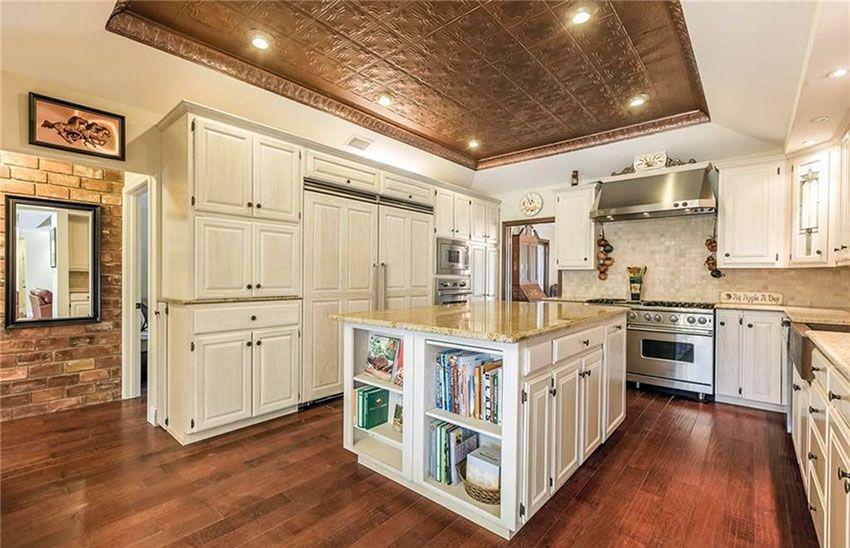 Kitchen With Cream Cabinets Integrated Refrigerator Custom Island And Hardwood Floors Cream Kitchen Cabinets Log Home Kitchens Black Kitchen Decor