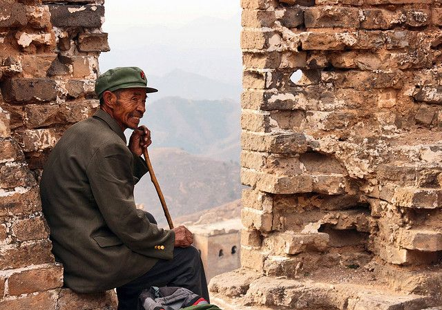 Man Sitting In Tower Of Great Wall Of China North Beijing Green Cap Cane Jacket Man Sitting Green Cap Great Wall Of China