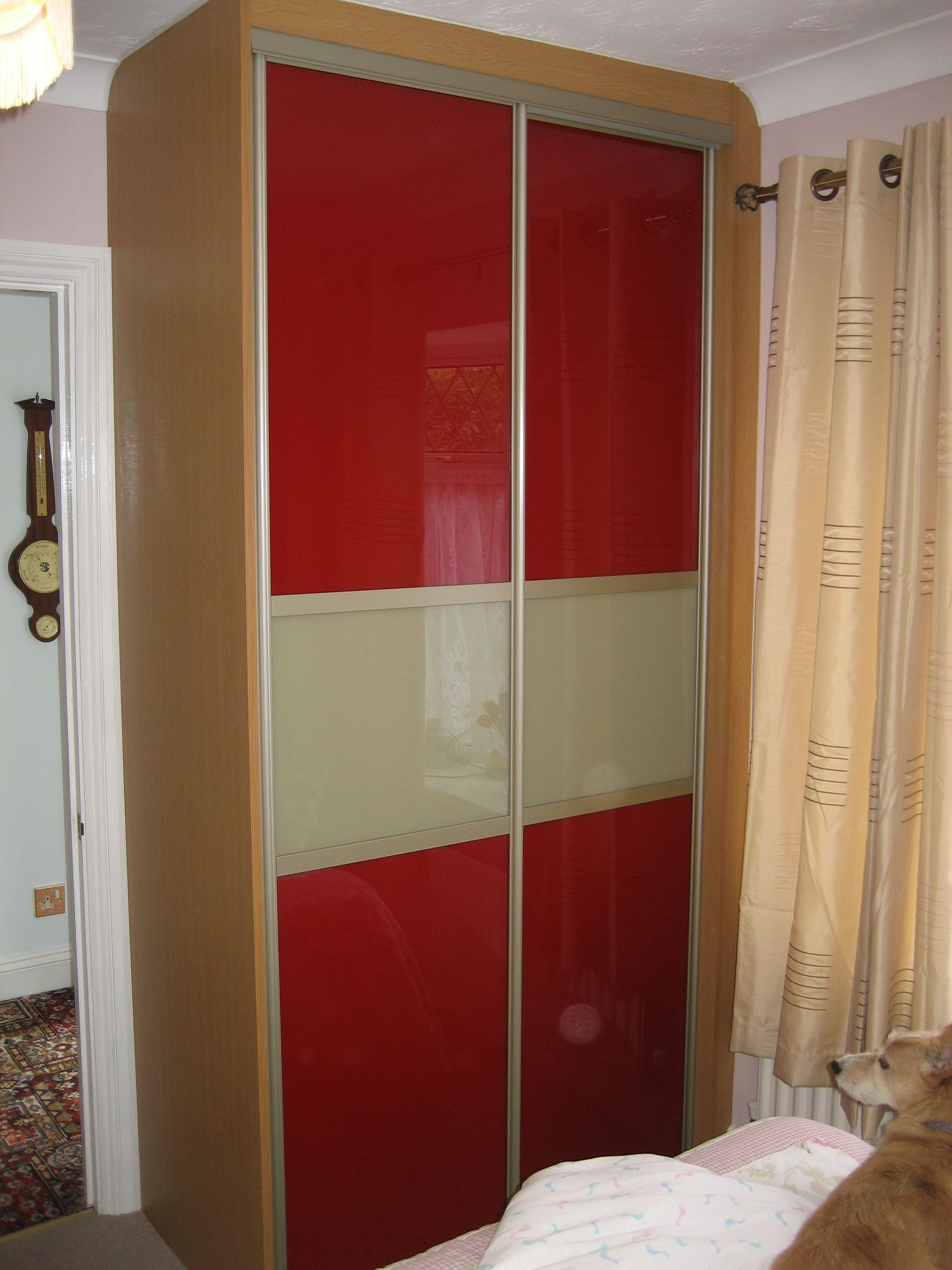 This Bespoke Wardrobe Features Crimson Red Glass Doors With Beige