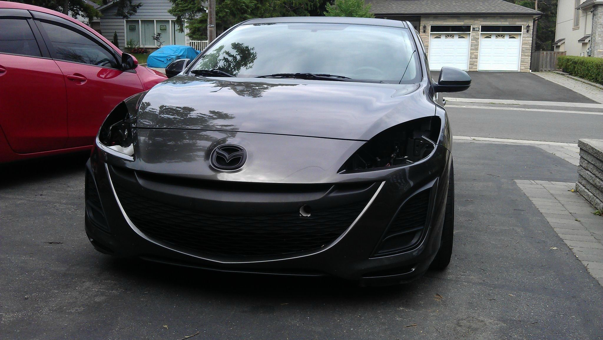 Mazda 3 Blacked Out Headlights And Emblem