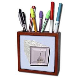 A 3D rectangular shape wrapped in metal on a light blue with Temple Tile Pen Holder