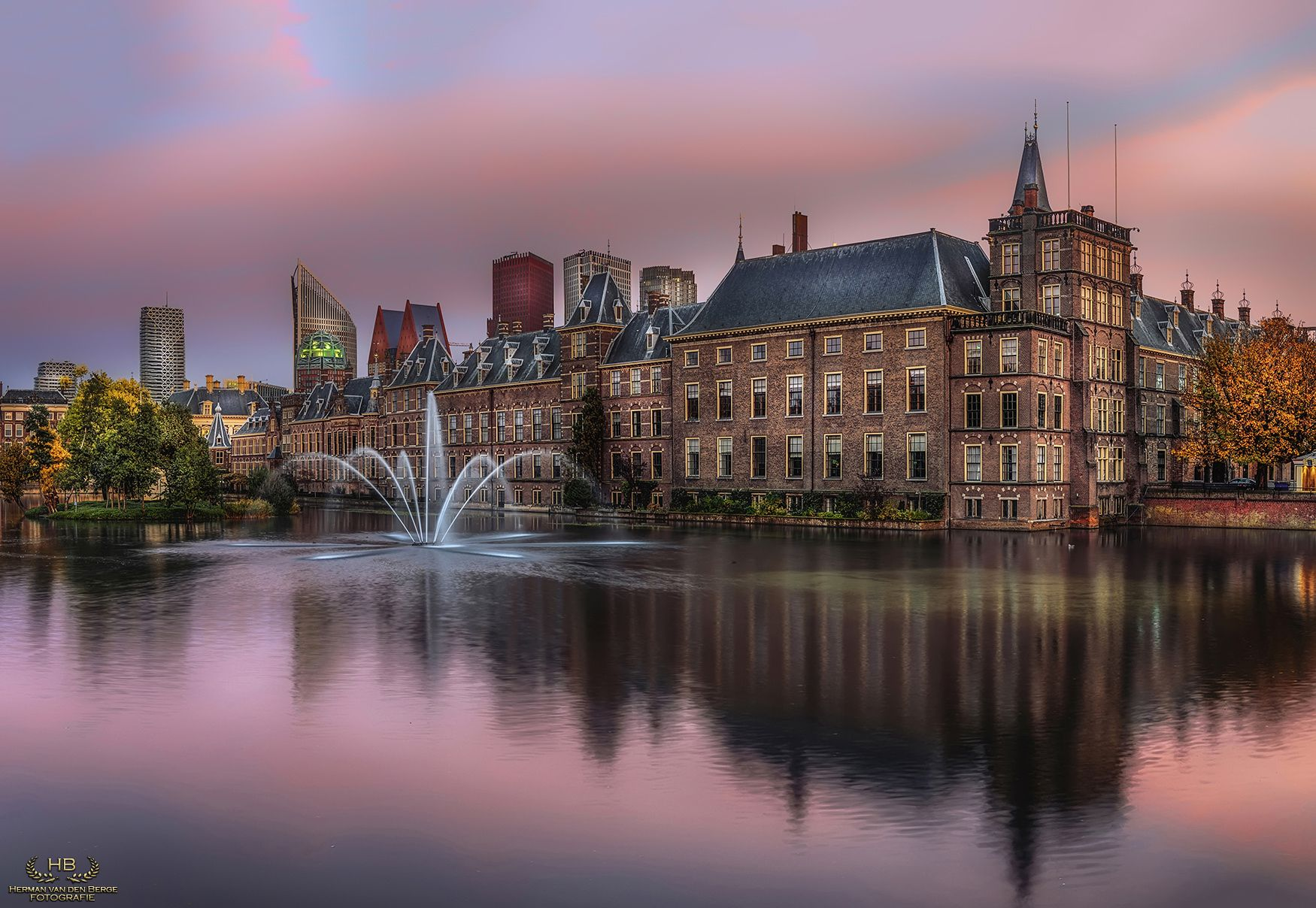 """Fountain of Wisdom - Front view of """"The Hofvijver"""" and the entrance to """"The Binnenhof"""", the place where the Dutch Government resides."""
