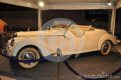 Old-timer completely white interior and white external color and white wheels of cabriolet coupe elegant elegantissimo