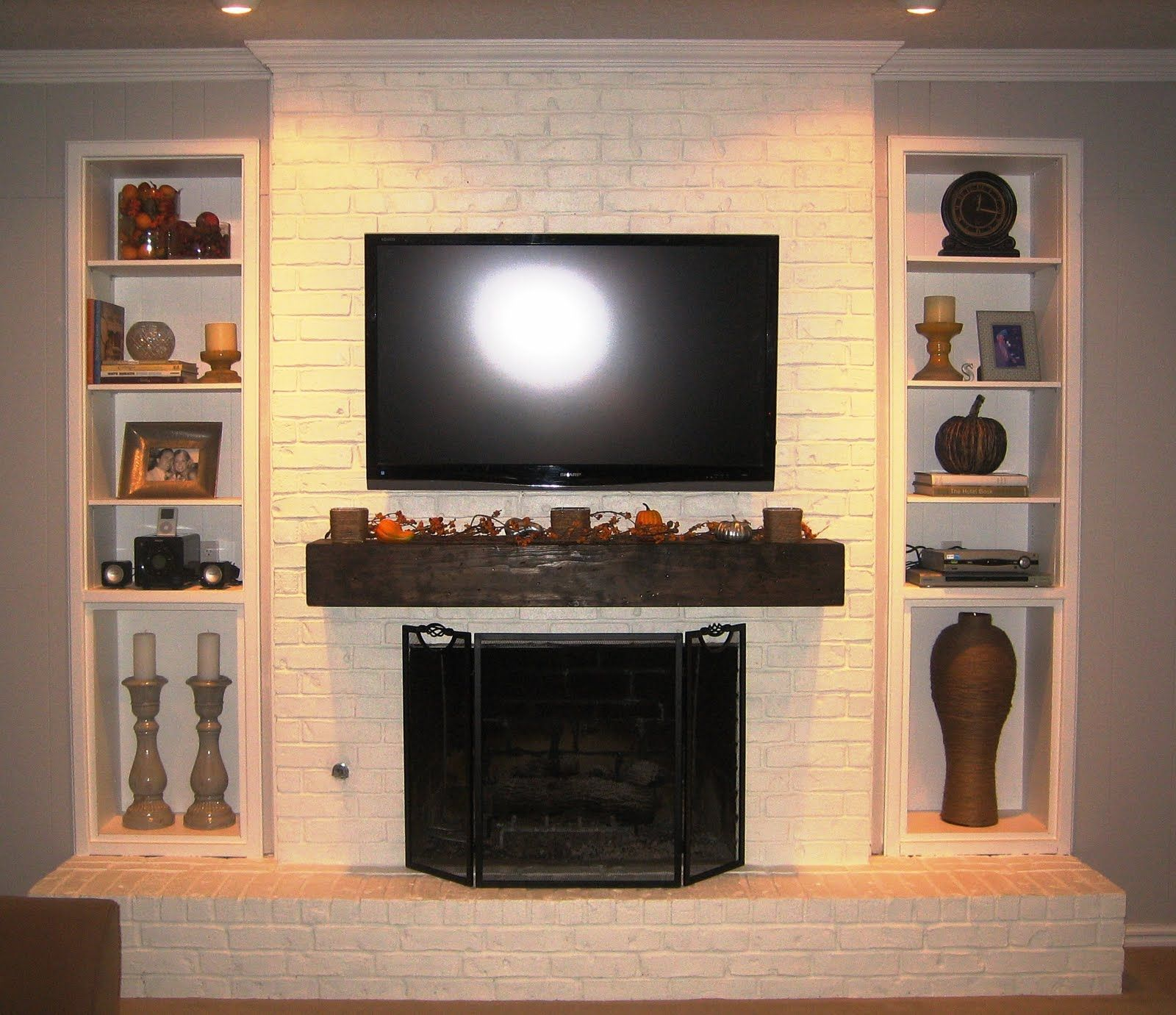 Homey Touch To Your Living With Brick Fireplace: Crown Molding And Interior  Paint Color With