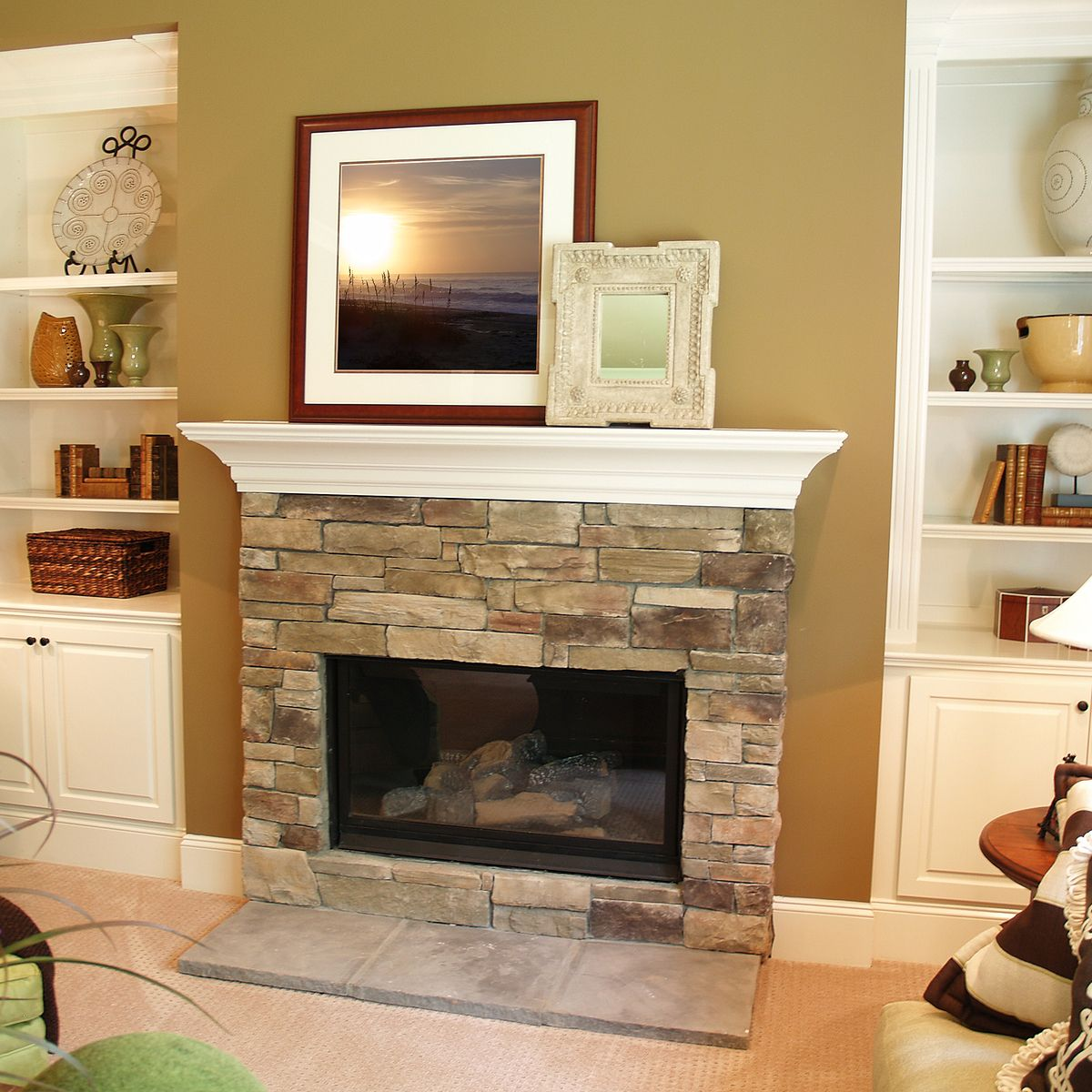 mantel makeover ideas add frames of different sizes and styles to