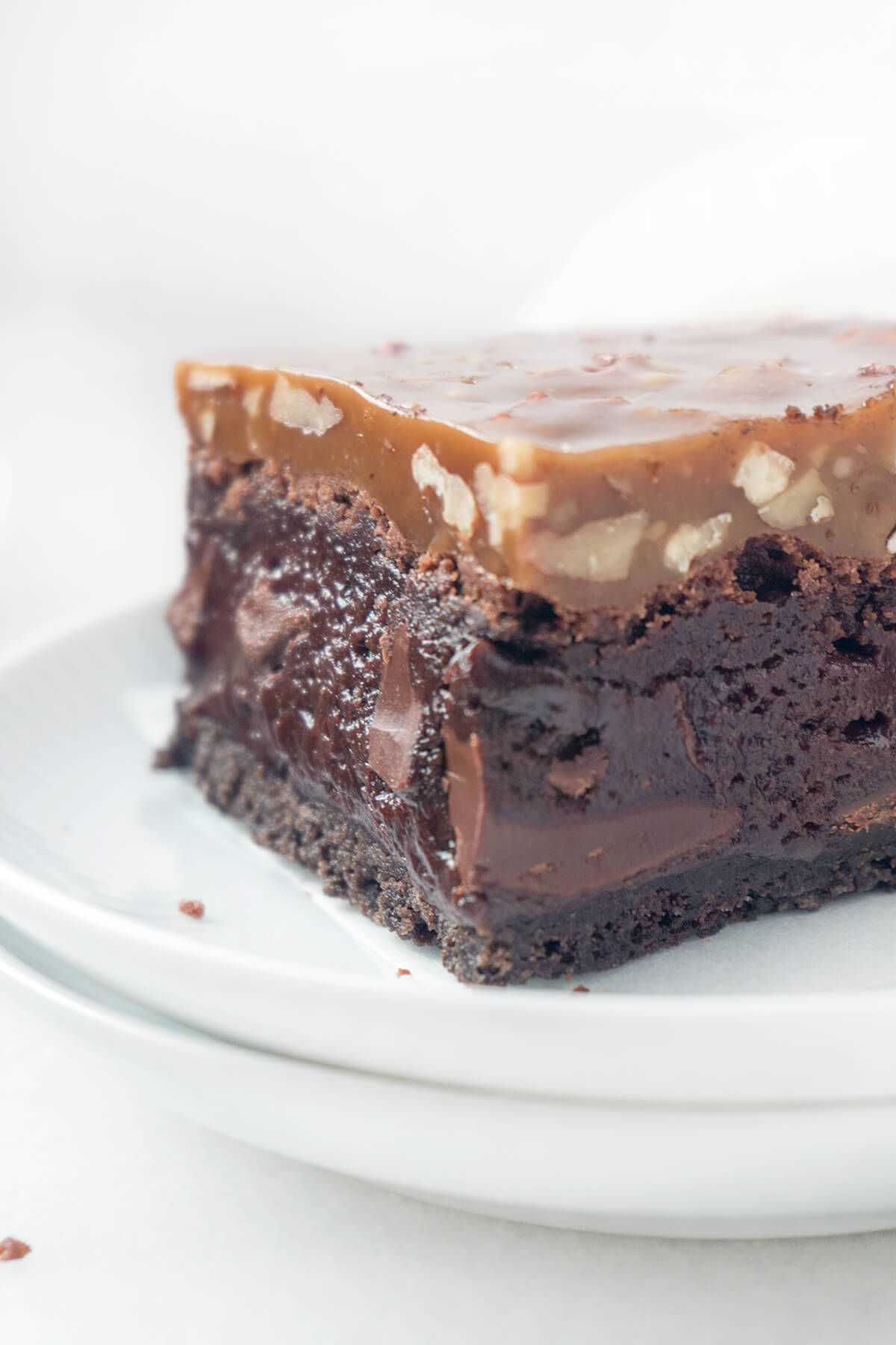 Fudgy Caramel Pecan Turtle Brownies #turtlebrownies Triple-layer Fudgy Caramel Pecan Turtle Brownies - a dense, fudgy brownie on top of an Oreo cookie crust topped with a chewy caramel and pecan topping. #turtlebrownies Fudgy Caramel Pecan Turtle Brownies #turtlebrownies Triple-layer Fudgy Caramel Pecan Turtle Brownies - a dense, fudgy brownie on top of an Oreo cookie crust topped with a chewy caramel and pecan topping. #turtlebrownies Fudgy Caramel Pecan Turtle Brownies #turtlebrownies Triple-l #turtlebrownies