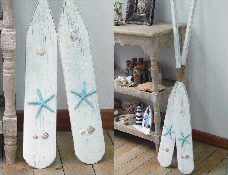 déco marine originale avec des coquillages et rames peintes blanches