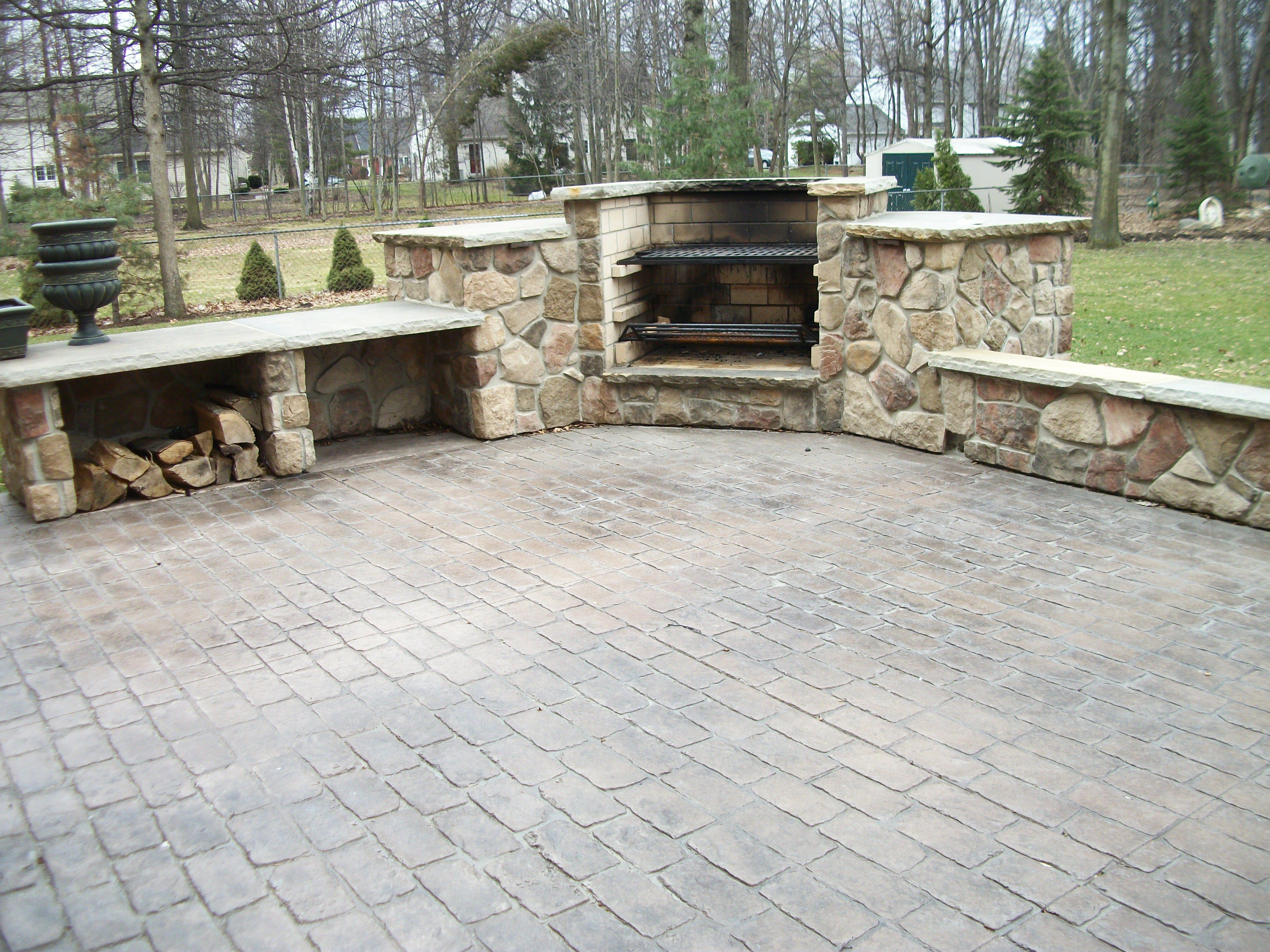Cobblestone Stamped Concrete Patio With Outdoor Cooking Fireplace