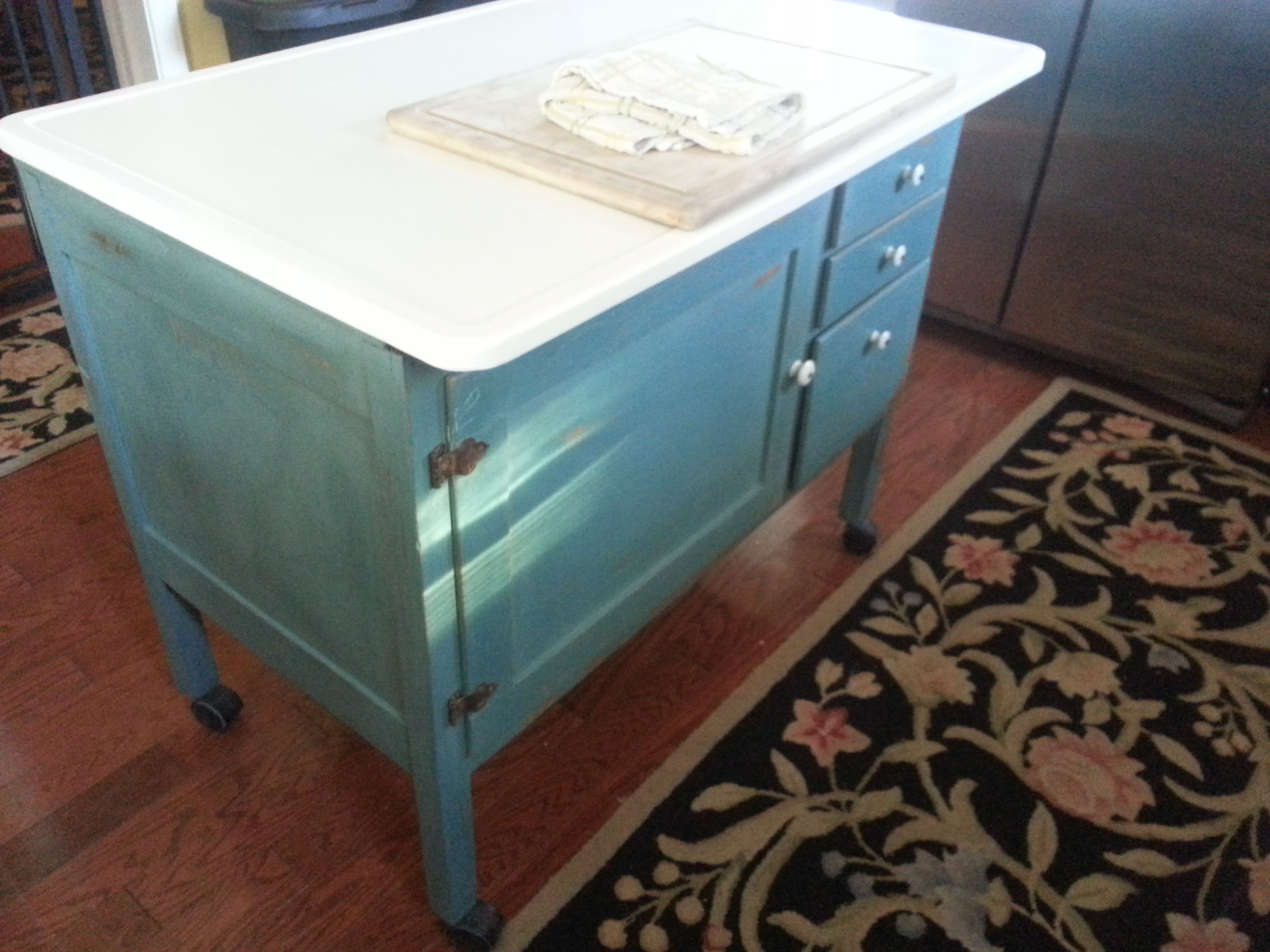 base of a hoosier cabinet refinished with miss mustard seed paint and now is a beautiful