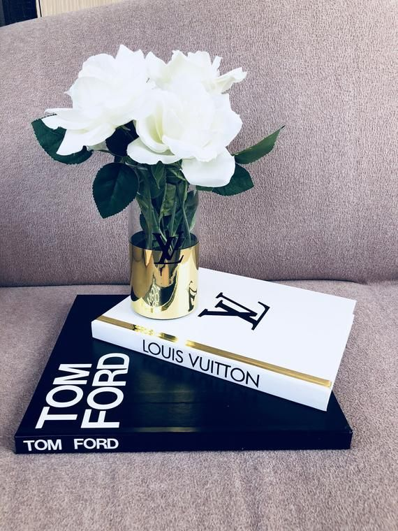 Decorative books only  vase with flowers are not included Super large hardcover books  Handmade vinyl covers and logos Size first book  12111 Size second book 118.51 Only 2 sets available in this sizes Feel free to ask me any questions I will be happy to assist you