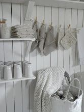 Pantry organization. Brilliant idea- hang pot holders and tea towels with clothes pins and rope!