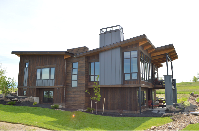 Montana mountain modern architecture utilizes reclaimed for Modern house siding solutions