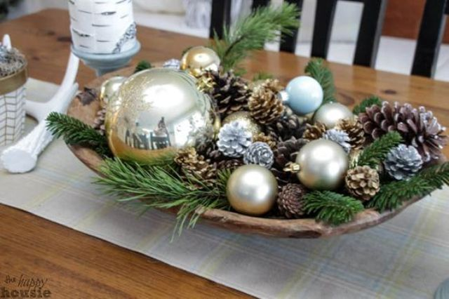 05 A Wooden Bowl With Pinecones Ornaments And Greenery Shelterness Christmas Table Decorations Christmas Decorations Rustic Christmas Dining Room