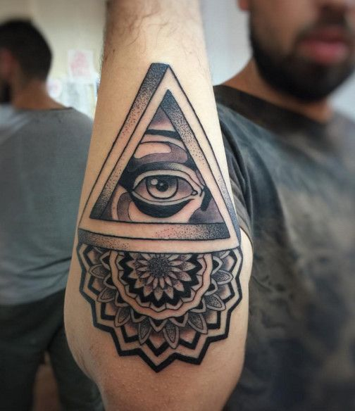 black and grey tattoo color of illuminati eye with tribal tattoo for hand tattoos design ideas. Black Bedroom Furniture Sets. Home Design Ideas