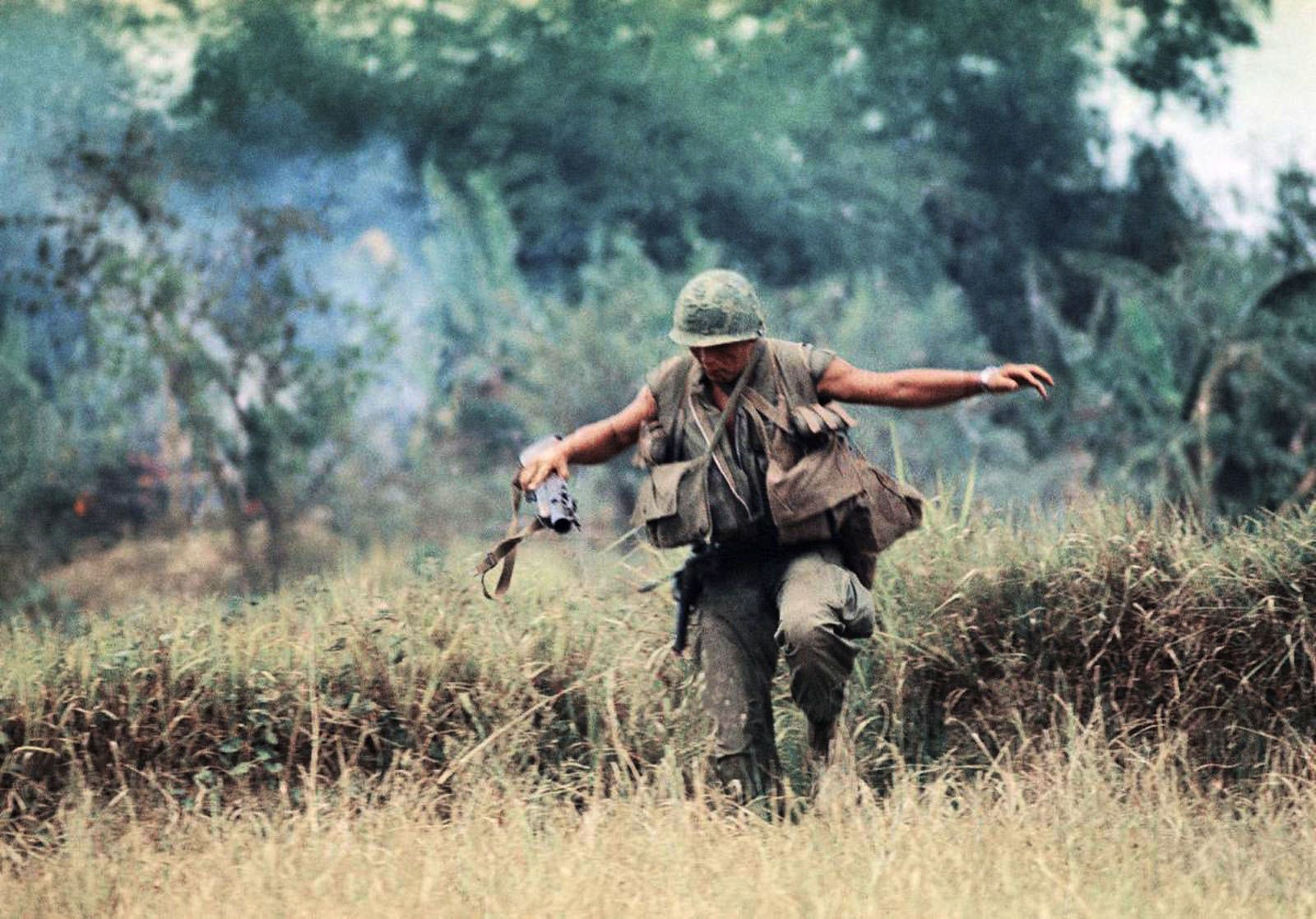 1965 Soldier crossing a field during the Vietnam War