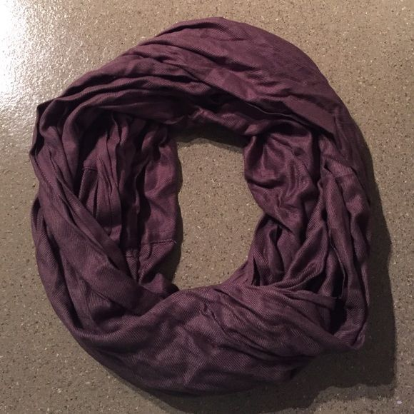 Purple/burgundy color infinity scarf. Gently used purple/burgundy/brown color infinity scarf. Accessories Scarves & Wraps