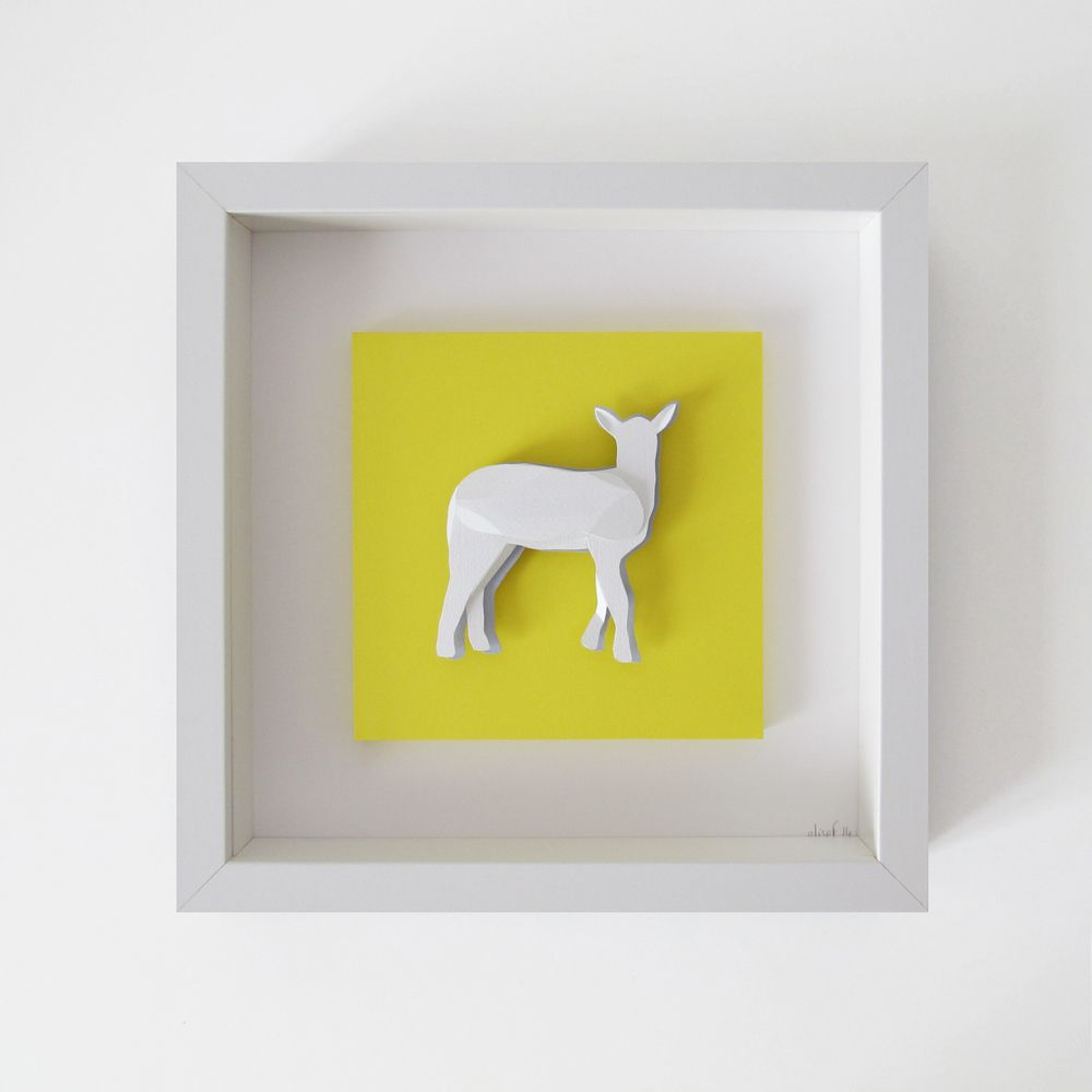 lamb silhouette, handmade with cut and folded paperwhite textured paper, yellow and light grey smooth paperwhite wood frame with glass : 25x25x4,5 cmAsk for a personalized animal frame!