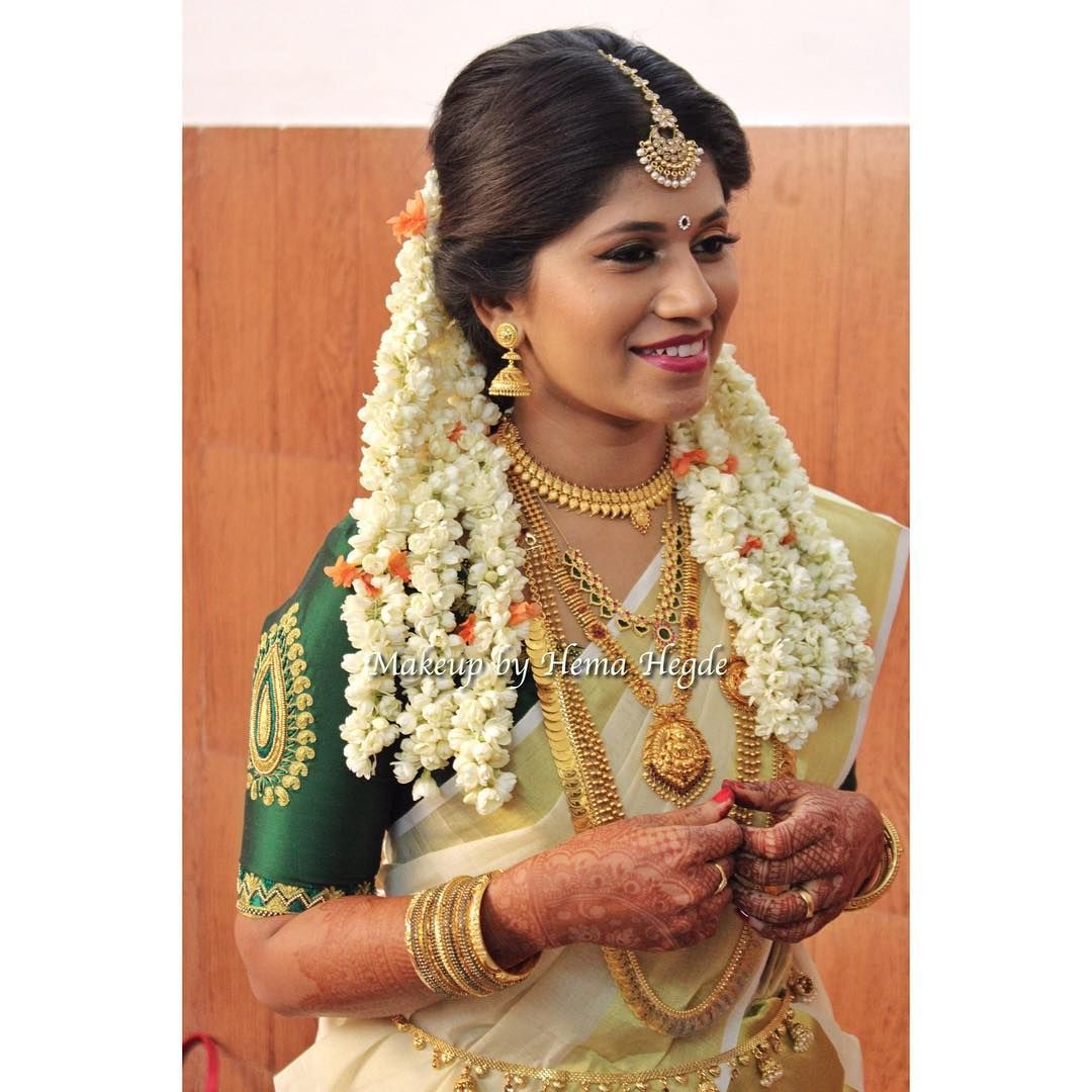 Hairstyles With Flowers Kerala: South Indian Bride. Kerala Bride. Kerala Bridal Saree Pink