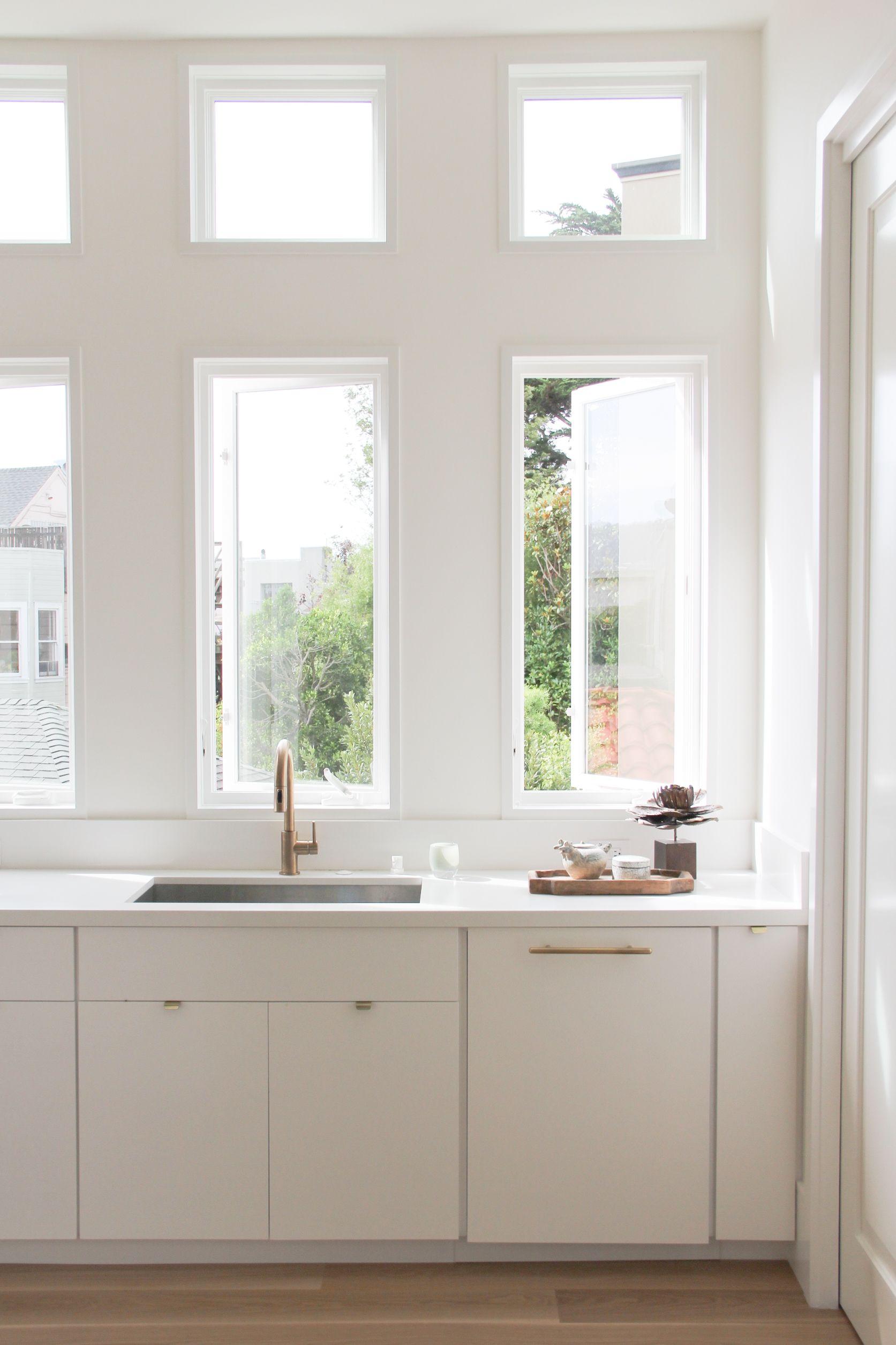 white kitchen, brass hardware, pivoting windows   Decorist Showhouse ...