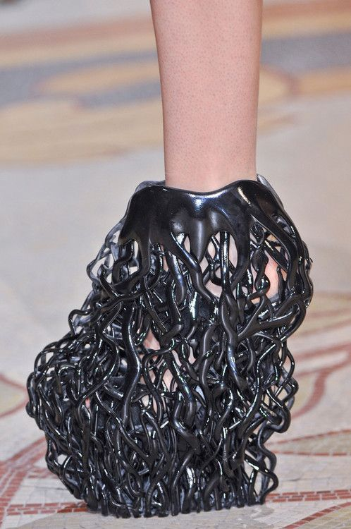 3D-Printed Shoes by Iris Van Herpen + Rem D Koolhaas Legendary fashion designer Iris van Herpen and shoe designer Rem D Koolhaas have collaborated to create this sick 3D-printed shoes that look like tree roots. The shoes were presented earlier this month at Paris Fashion Week during Iris van Herpen's Fall '13 couture show.