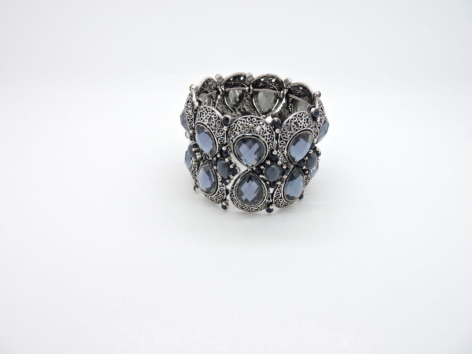 Raining Gems Bracelet from Helen's Jewels. #jewelry #bracelet #bracelets #jewelryonpinterest #etsy #etsyjewelry #helensjewels #fashion #style #accessories #wristcandy #gembracelet #metal #metalbracelet #cagebracelet