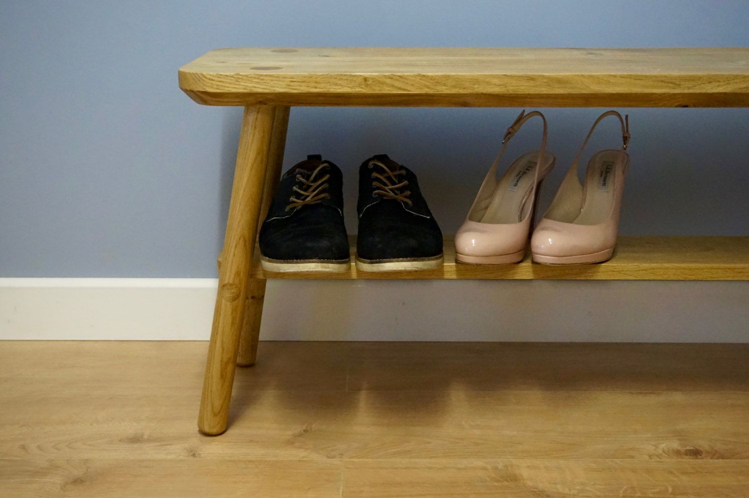 Made entirely from Oak, this bench is hand crafted using wedge joinery. Visible from the seat top and on the legs, the wedges are left showing to highlight the craftsmanship involved in constructing this bench.  Another key design feature is the simple shelf below the seat. http://jgriffindesign.co.uk/