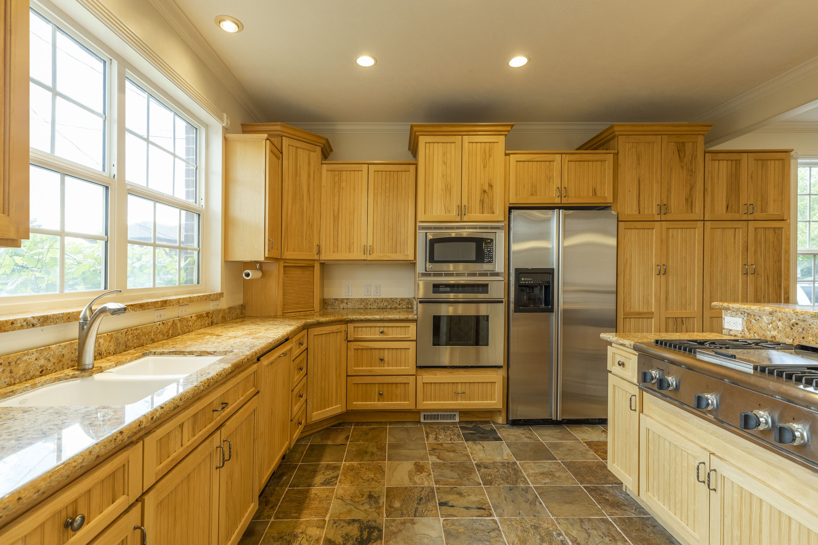 Check out the kitchen with its open plan and plenty of counter top space with a built in gas burning stove. #Kitchen #WindermereUtah #UtahHomes #KitchenDesign #RealEstate #NaturalKitchen #WoodCabinetry #KitchenIsland #InteriorDesign #HomeDesign #HomeDecor