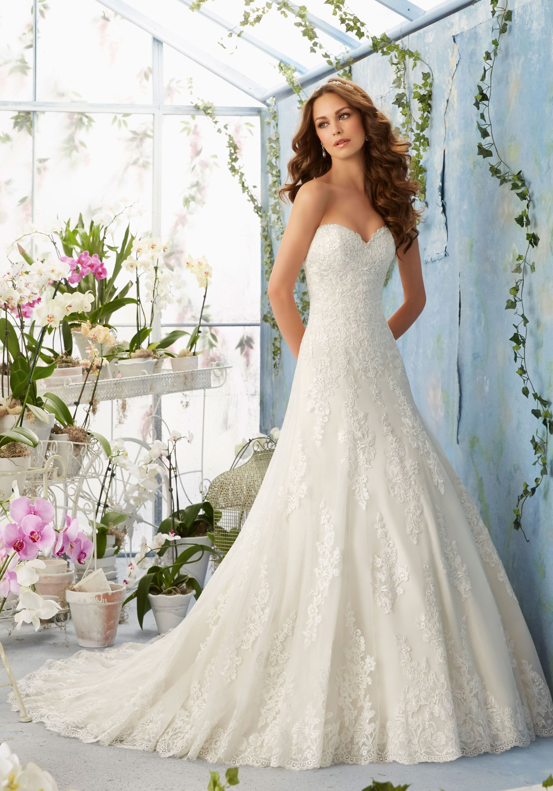 Embroidered Lace Appliques Decorate the Net Dress with Scalloped ...