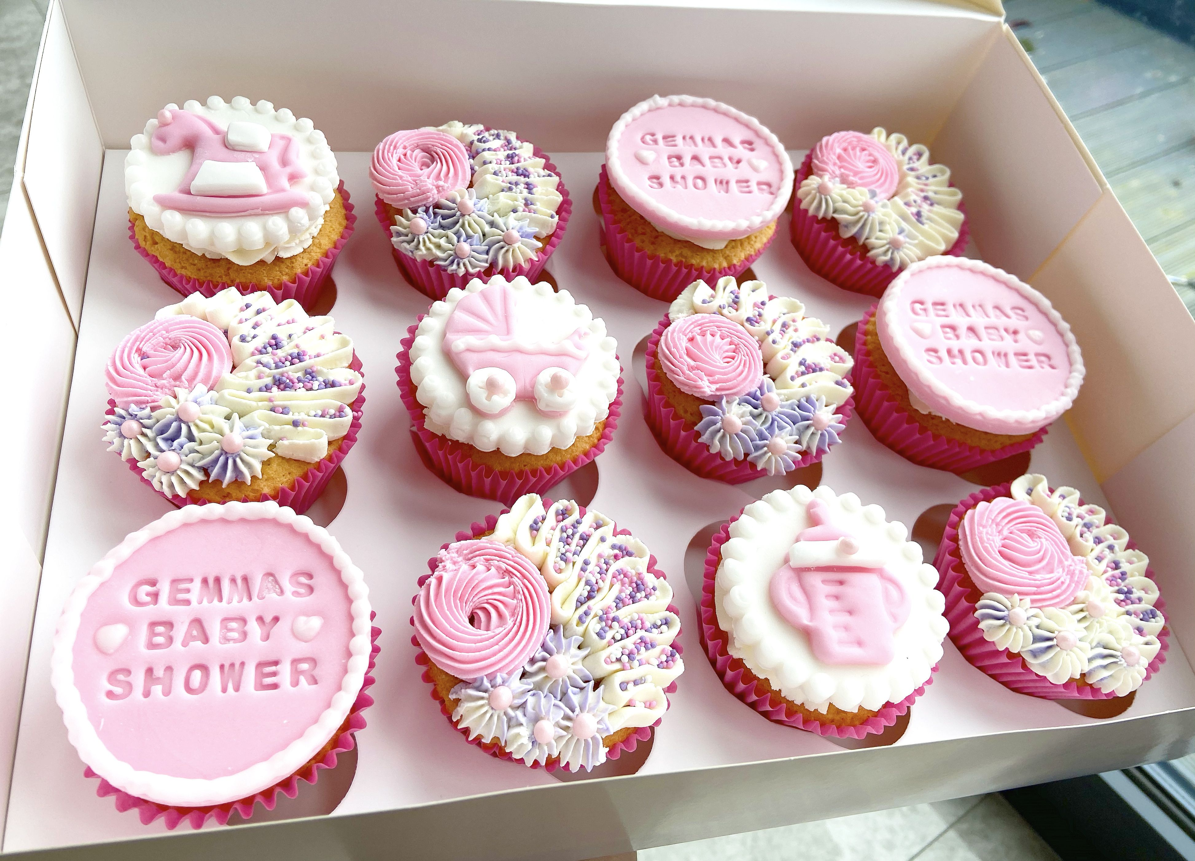 Baby Girl Baby Shower Cupcakes In Pink Purple And White Cerise Pink Cases Buttercream S Baby Shower Cupcakes For Girls Baby Shower Purple Baby Shower Cupcakes