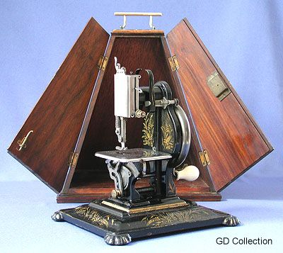 The Dorman Portable Lockstitch Machine was manufactured in Northampton, U.K. during the late 1880's.  The machine itself is mainly fabricated from pressed steel. The heavy iron base (for stability) was an optional extra. This example features the rare and desirable pyramidal walnut cabinet.