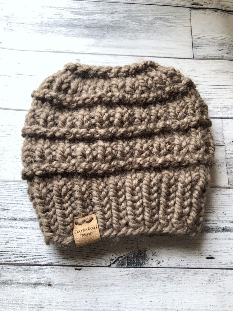 Messy bun beanie, knit messy bun beanie, top knot beanie, bun hat, knit bun hat, ponytail beanie, ponytail hat, messy bun hat, chunky hat #messybunhat Excited to share this item from my #etsy shop: Messy bun beanie, knit messy bun beanie, top knot beanie, bun hat, knit bun hat, ponytail beanie, ponytail hat, messy bun hat, chunky hat #accessories #hat #christmas #chunkybeanie #knittopknothat #adultbeanie #knitmessybun #knitbunbeanie #viralbunbeanie #messybunhat Messy bun beanie, knit messy bun b #messybunhat