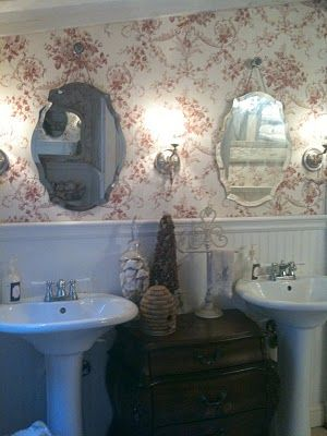 Photo of I love the pedastal sinks and cabinet in-between.