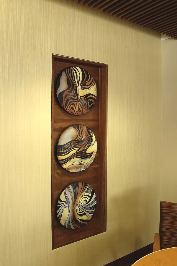 Each of these ceramic wall tiles, in the shape of discs, is 18\