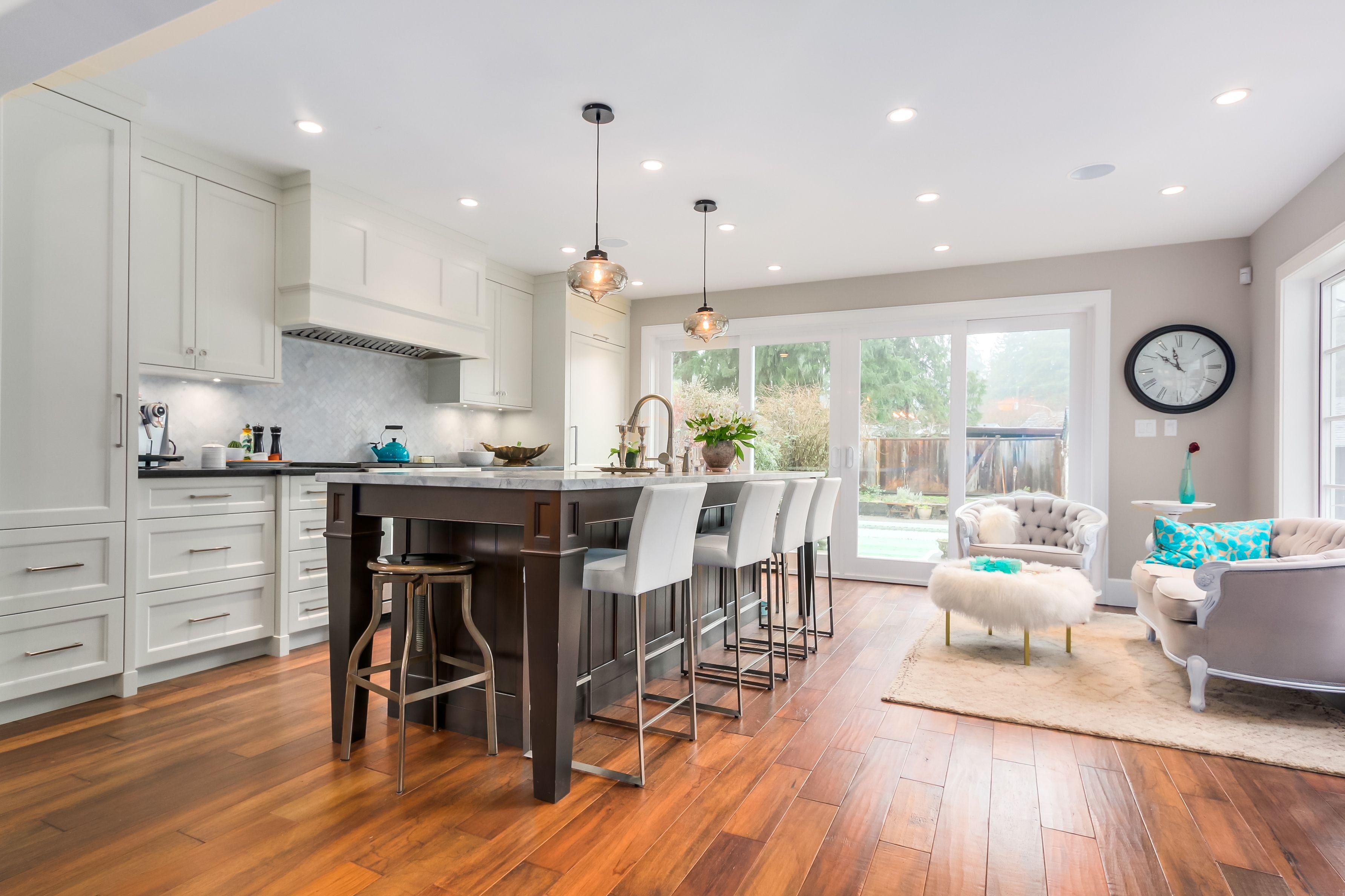 Open kitchen with custom island, white cabinets, herringbone ...