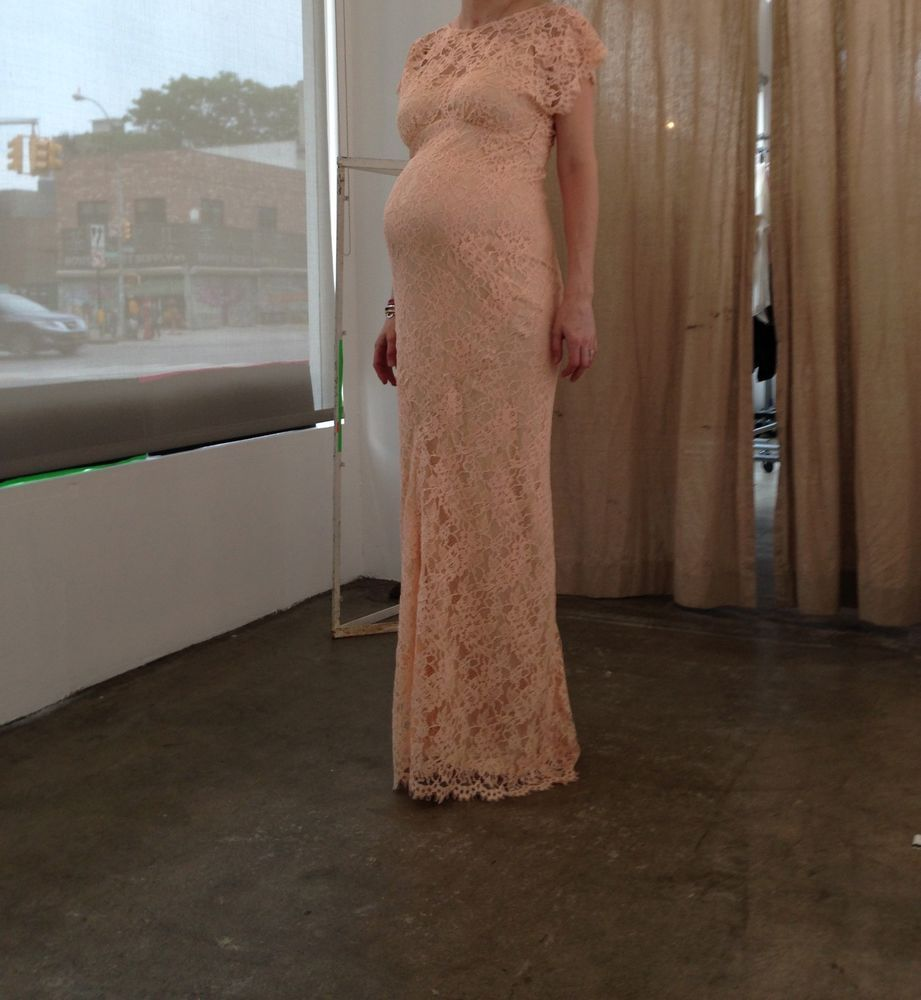 Blush colored lace maternity gown perfect for wedding or evening