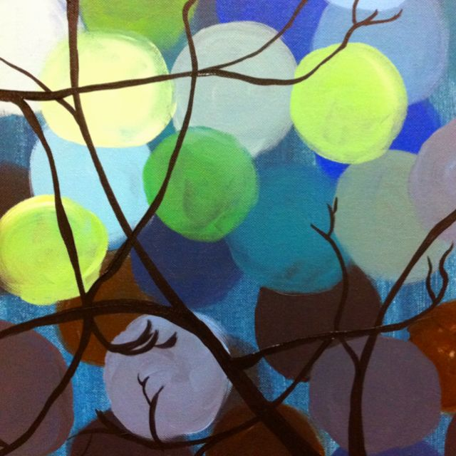 Tree silhouette with circles on canvas.  Do a base coat, then darkest to lightest circles. Add the tree last.