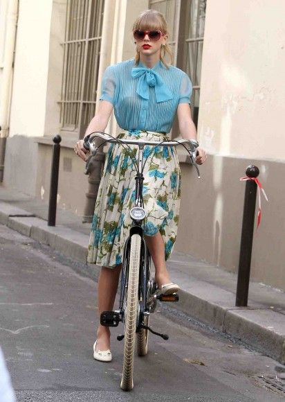 Blue and white floral skirt with white cat flats on Begin Again music video