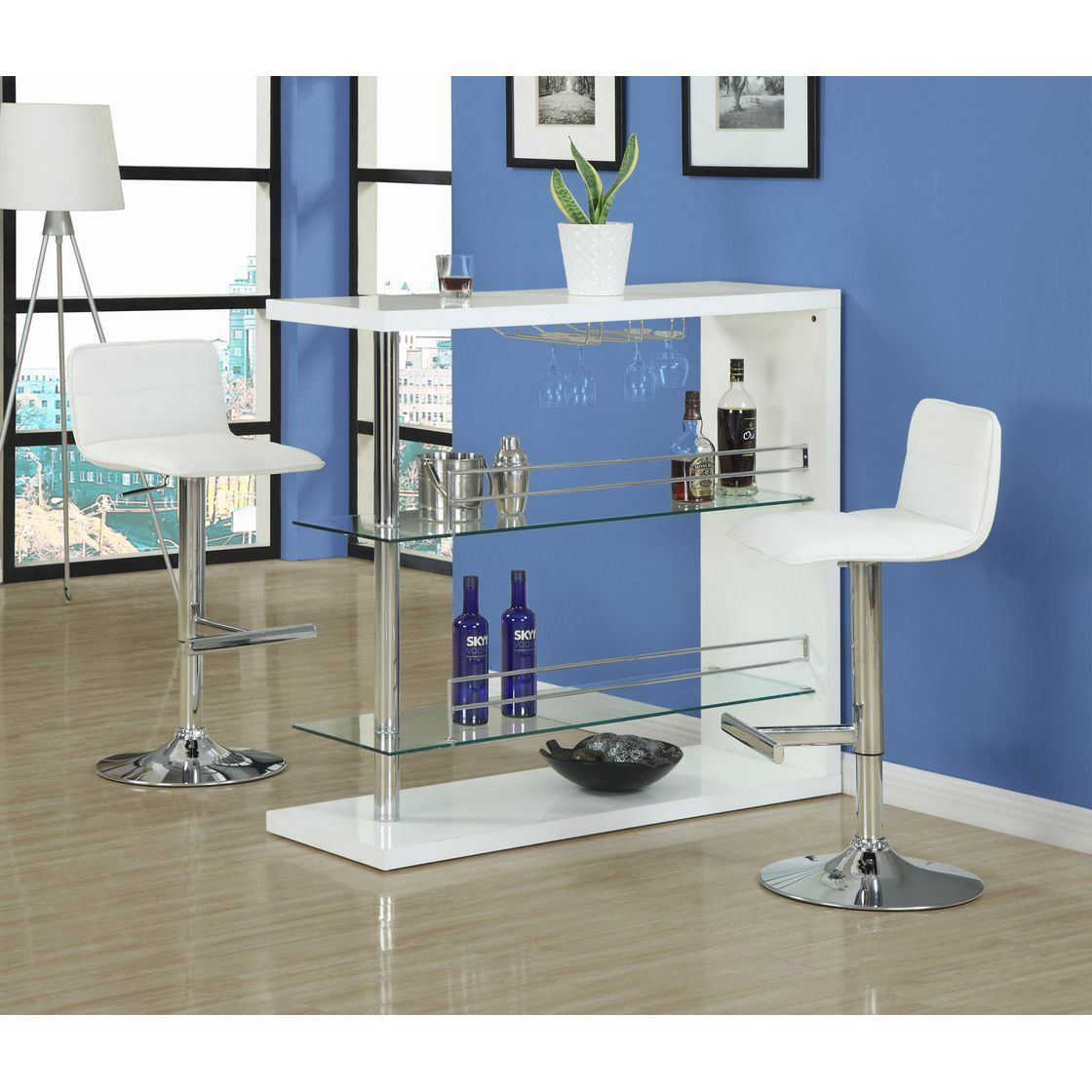 This chrome bar table is a modern take on a classic. With two glass ...